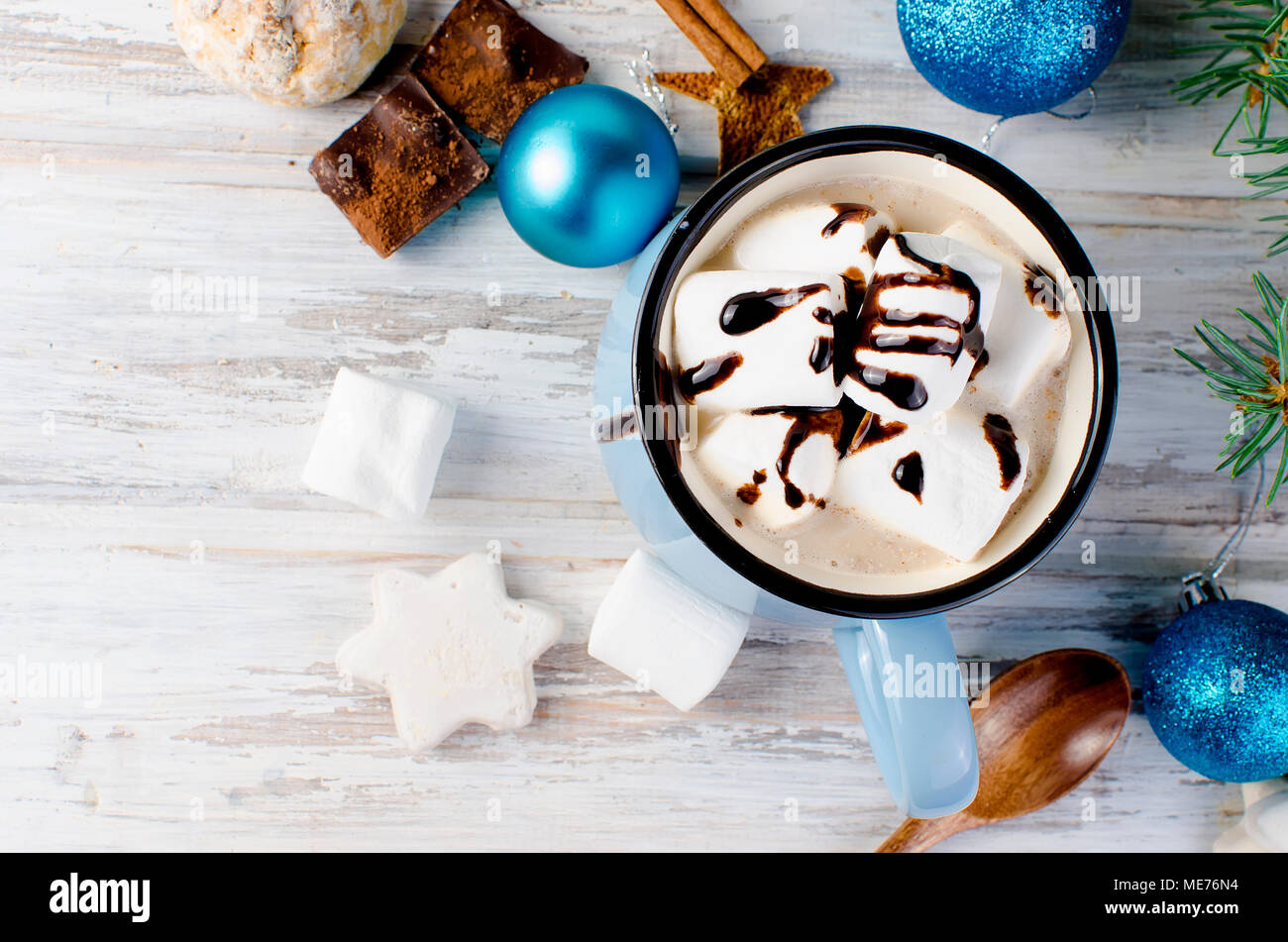 Christmas traditional hot drink cocoa in blue cup, fir branches and ...