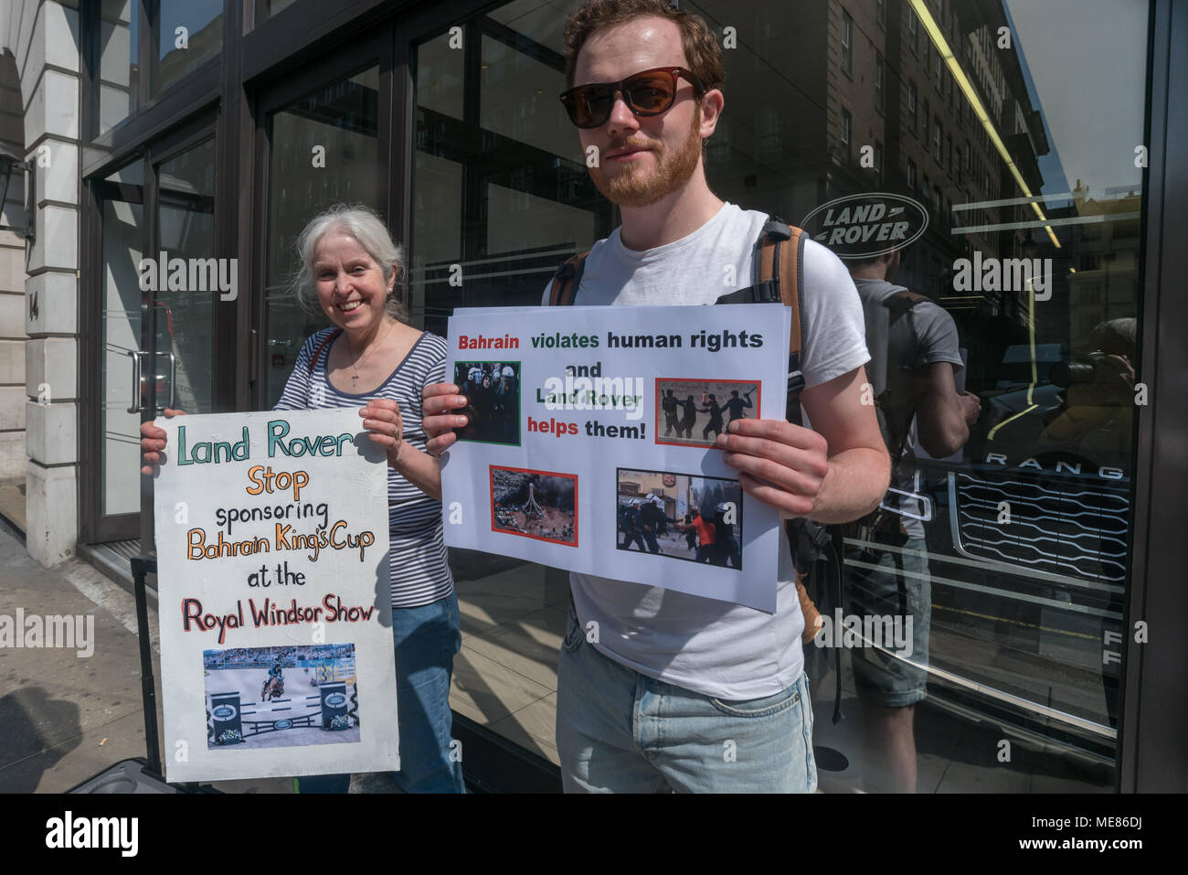 London, UK. 21st April 2018, Campaigners from CAAT (Campaign Against Arms Trade) protest outside the Land Rover showroom in Mayfair against their continuing sale of military vehicles to the Bahraini regime, and their sponsorship for the Royal Windsor Horse Show where Bahrain's King Hamad bin Isa al-Khalifa will join the Queen on May 12th. Despite Bahrain's horrific and deteriorating human rights record, Britain still sells large volumes of arms to the regime, over £82m licenced exports since the 2011 pro-democracy rising. Credit: Peter Marshall/Alamy Live News - Stock Image