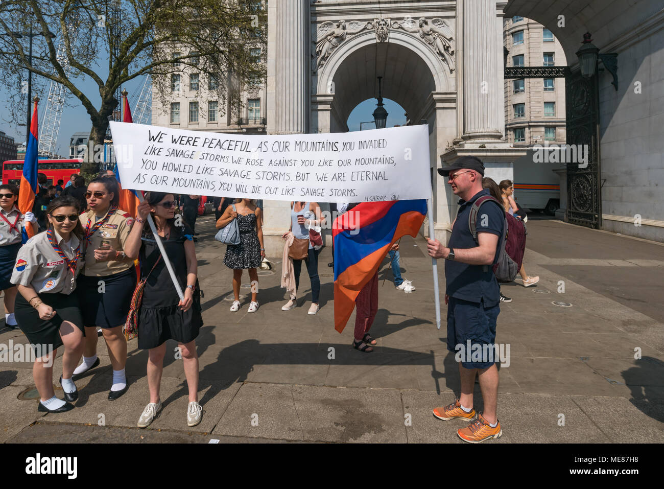 London, UK. 21st April 2018. Armenians meet at Marble Arch to march through London to the Cenotaph at the start of a series of events commemorating the 103rd anniversary of the beginning of the Armenian Genocide.  A banner has a poem written in 1941 by H Shiraz, 'We were peaceful as our mountains You invaded like savage storms. We rose against you like our mountains, You howled like savage storms. Credit: Peter Marshall/Alamy Live News - Stock Image