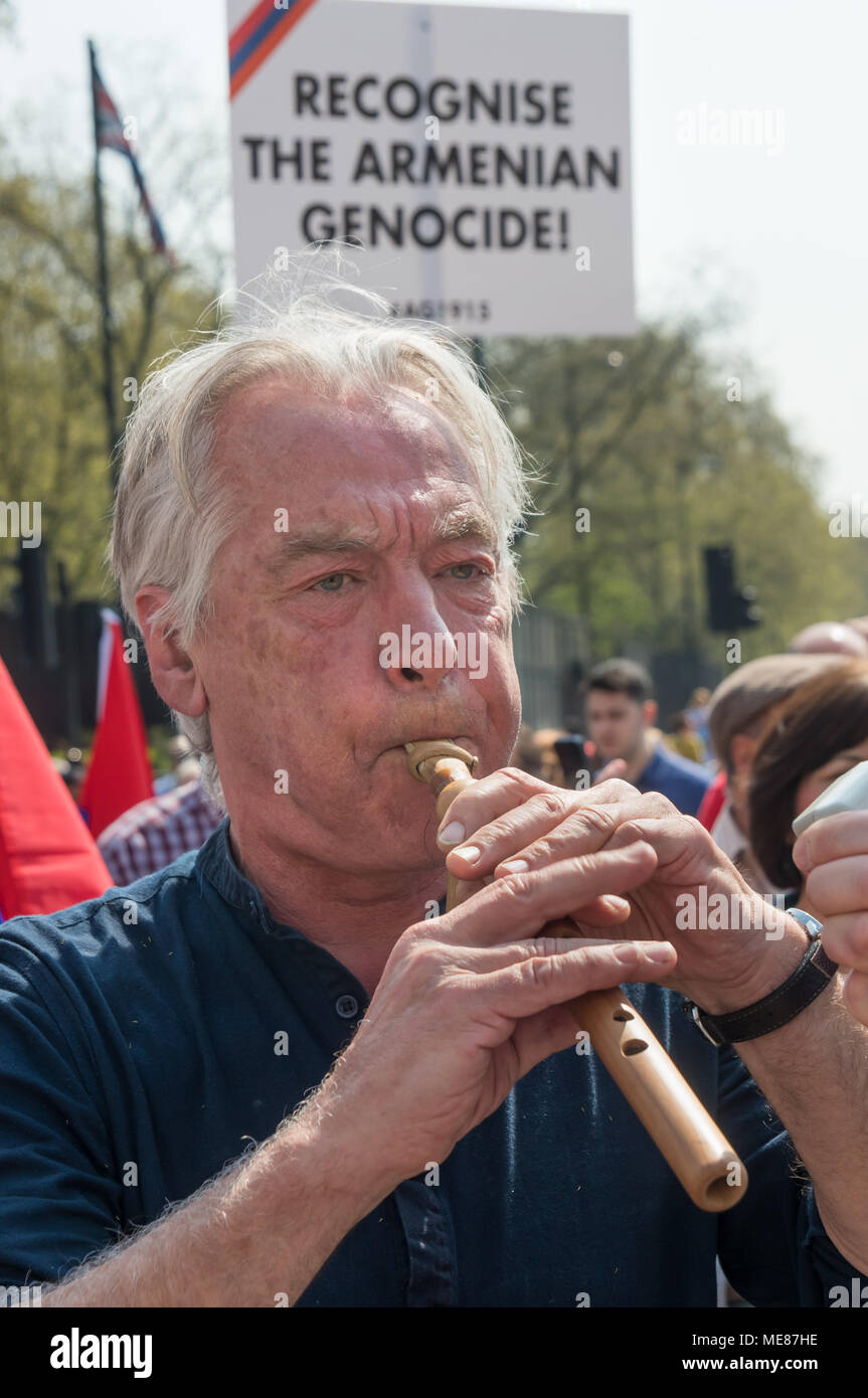 London, UK. 21st April 2018. Dirk Campbell, the father of Anna Campbell, a British volunteer killed fighting for Afrin in the Kurdish YPJ plays a traditional Aremnian Duduk flute to Armenians meeting to march through London from Marble Arch to the Cenotaph at the start of a series of events commemorating the 103rd anniversary of the beginning of the Armenian Genocide. They demand the UK to follow the lead of many other countries and recognise the Armenian genocide. Between 1915 and 1923 Turkey killed 1. Credit: Peter Marshall/Alamy Live News - Stock Image