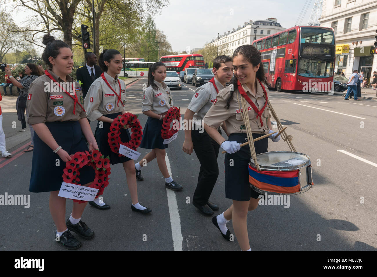 London, UK. 21st April 2018. Armenian Scouts set off with a drummer and carrying wreaths leading the Armenian march through London from Marble Arch to the Cenotaph at the start of a series of events commemorating the 103rd anniversary of the beginning of the Armenian Genocide. They demand the UK follow the lead of many other countries and recognise the Armenian genocide. Between 1915 and 1923 Turkey killed 1.5m Armenians, around 70% of the Armenian population, but Turkey still refuses to accept these mass killings as genocide. Credit: Peter Marshall/Alamy Live News - Stock Image