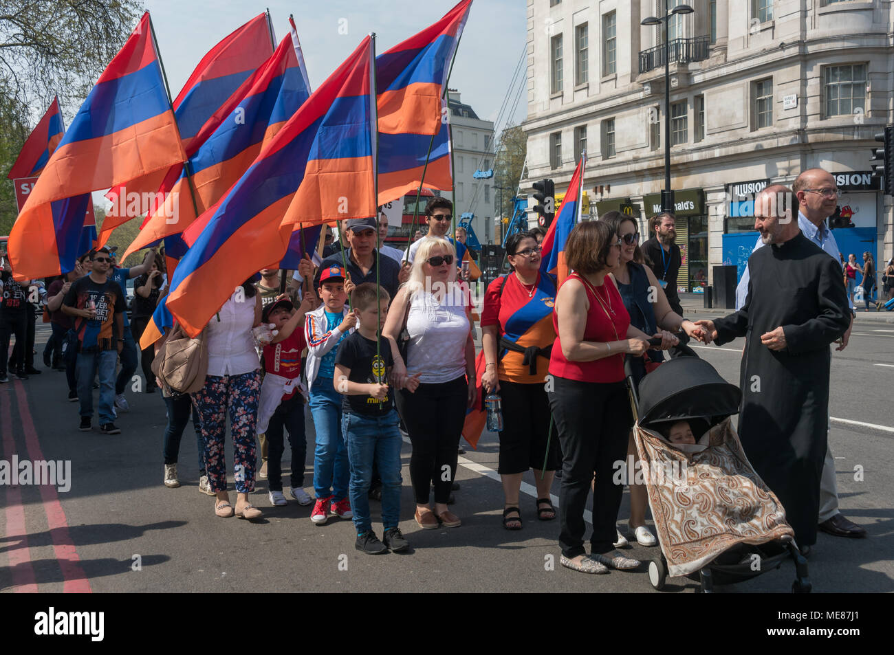 London, UK. 21st April 2018. Armenians march through London from Marble Arch to the Cenotaph at the start of a series of events commemorating the 103rd anniversary of the beginning of the Armenian Genocide. They demand the UK follow the lead of many other countries and recognise the Armenian genocide. Between 1915 and 1923 Turkey killed 1.5m Armenians, around 70% of the Armenian population, but Turkey still refuses to accept these mass killings as genocide. Credit: Peter Marshall/Alamy Live News - Stock Image