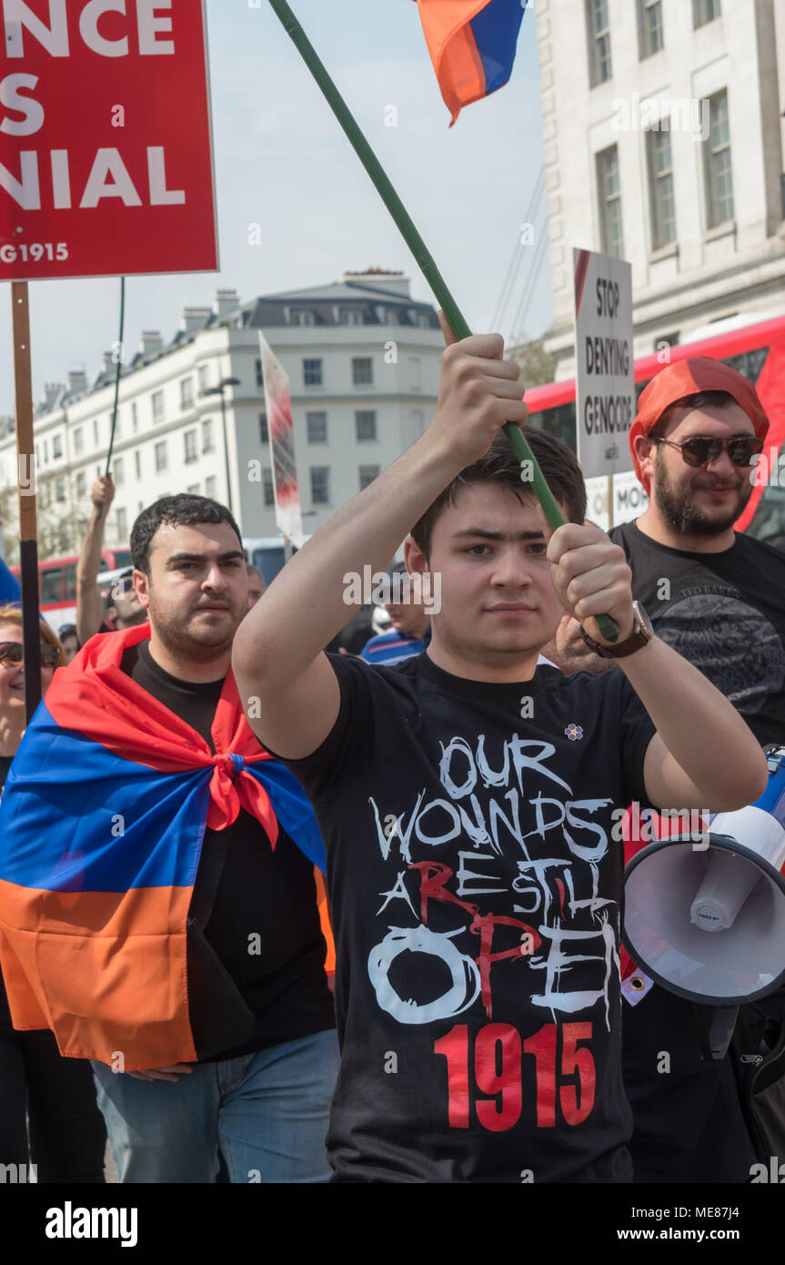 London, UK. 21st April 2018. Armenians march through London from Marble Arch to the Cenotaph at the start of a series of events commemorating the 103rd anniversary of the beginning of the Armenian Genocide. They demand the UK follow the lead of many other countries and recognise the Armenian genocide. Some wore t-shirts with the message 'Our Wounds Are Still Open 1915'. Between 1915 and 1923 Turkey killed 1.5m Armenians, around 70% of the Armenian population, but Turkey still refuses to accept these mass killings as genocide. Credit: Peter Marshall/Alamy Live News - Stock Image