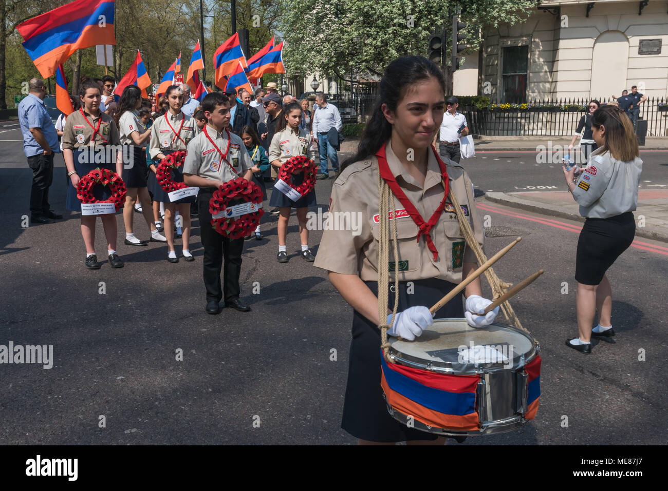 London, UK. 21st April 2018. Armenian Scouts with a drummer and four scouts carrying wreaths leading the Armenian march through London from Marble Arch to the Cenotaph at the start of a series of events commemorating the 103rd anniversary of the beginning of the Armenian Genocide. They demand the UK follow the lead of many other countries and recognise the Armenian genocide. Between 1915 and 1923 Turkey killed 1.5m Armenians, around 70% of the Armenian population, but Turkey still refuses to accept these mass killings as genocide. Credit: Peter Marshall/Alamy Live News - Stock Image