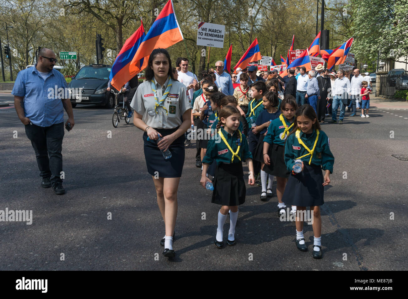 London, UK. 21st April 2018. Young Armenian Scouts march through London from Marble Arch to the Cenotaph at the start of a series of events commemorating the 103rd anniversary of the beginning of the Armenian Genocide. They demand the UK follow the lead of many other countries and recognise the Armenian genocide. Between 1915 and 1923 Turkey killed 1.5m Armenians, around 70% of the Armenian population, but Turkey still refuses to accept these mass killings as genocide. Credit: Peter Marshall/Alamy Live News - Stock Image