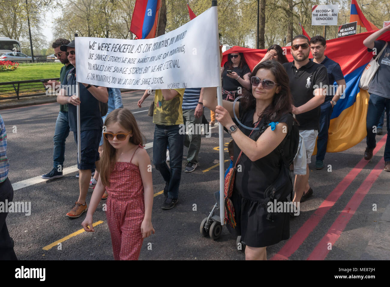 London, UK. 21st April 2018. Armenians carry a banner with a 1941 poem by H Shiraz, 'We were peaceful as our mountains You invaded like savage storms. We rose against you like our mountains, You howled like savage storms. But we are eternal as our mountains. You will die out like savage storms' on the march through London from Marble Arch to the Cenotaph at the start of a series of events commemorating the 103rd anniversary of the beginning of the Armenian Genocide. Credit: Peter Marshall/Alamy Live News - Stock Image