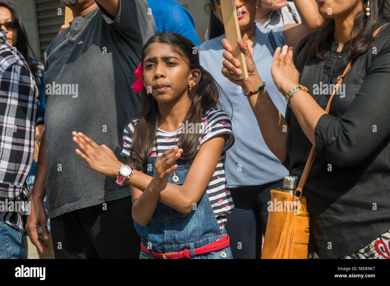 London, UK, 21 April 2018. London, UK. 21st April 2018. A young girl crosses her arms at the protest at India House calling for the Indian government to take effective action against the rape culture that they say has been encouraged by members of the ruling BJP party, leading to an increasing number of crimes against women. Credit: Peter Marshall/Alamy Live News - Stock Image