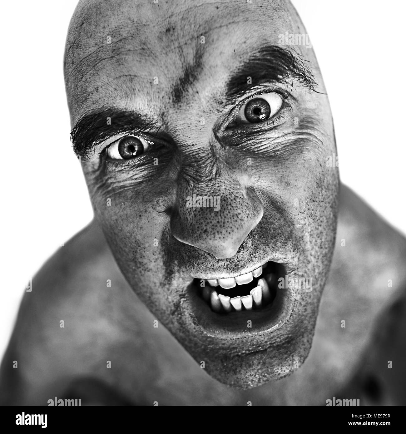Black and white portrait of mad man processed using the dragan effect. - Stock Image