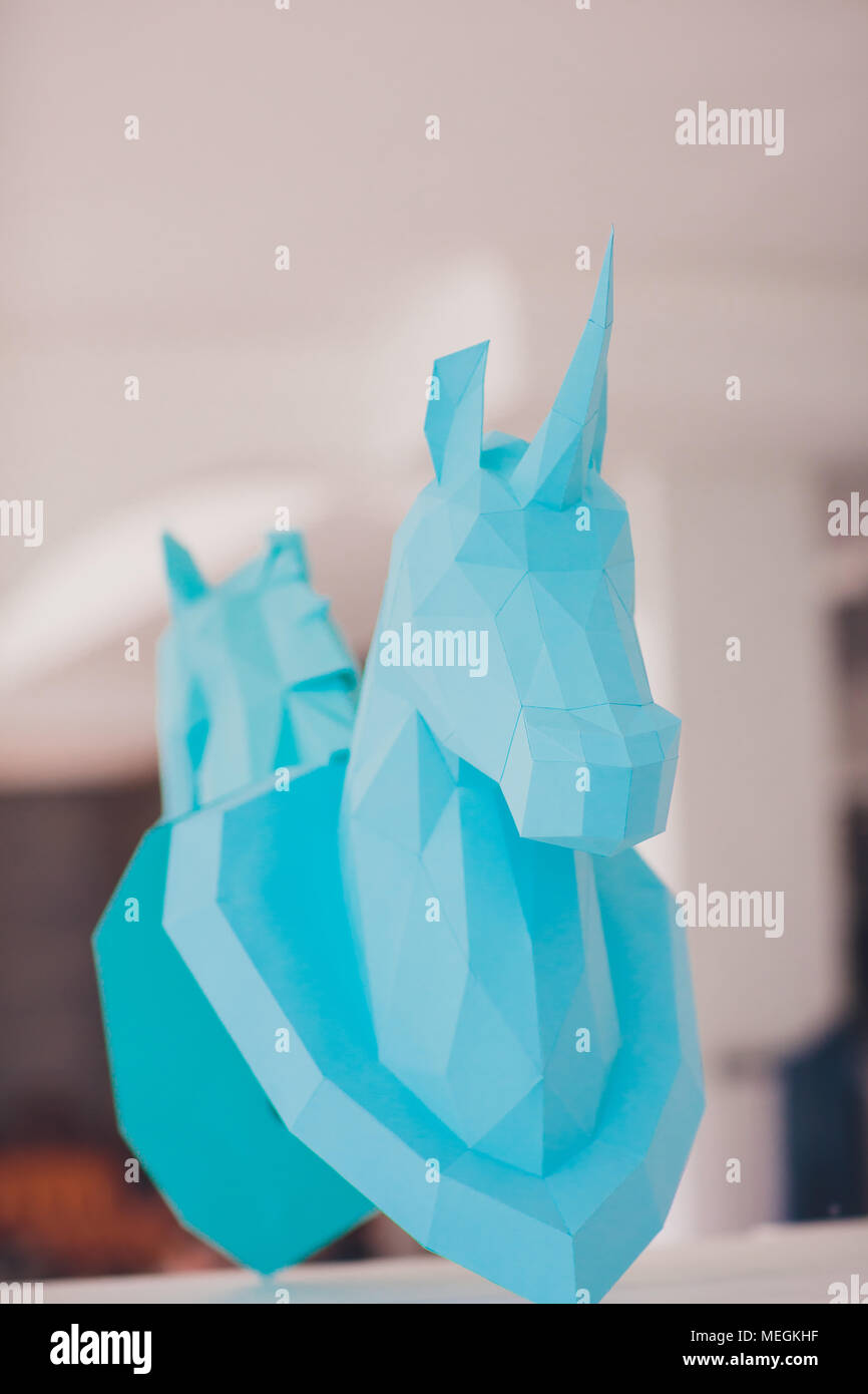 unicorn head paper on the wall mirror light interior studio - Stock Image