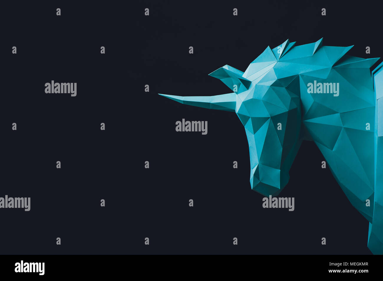Unicorn turquoise head paper isolated on black background. Copy space - Stock Image