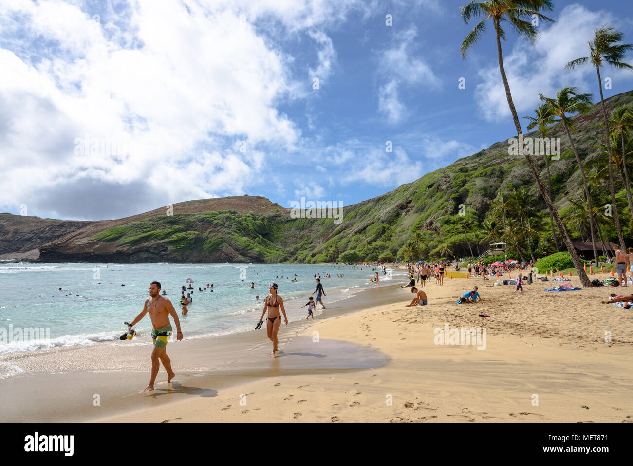 Tourists on the beach at Hanauma Bay, Honolulu, Hawaii Stock Photo