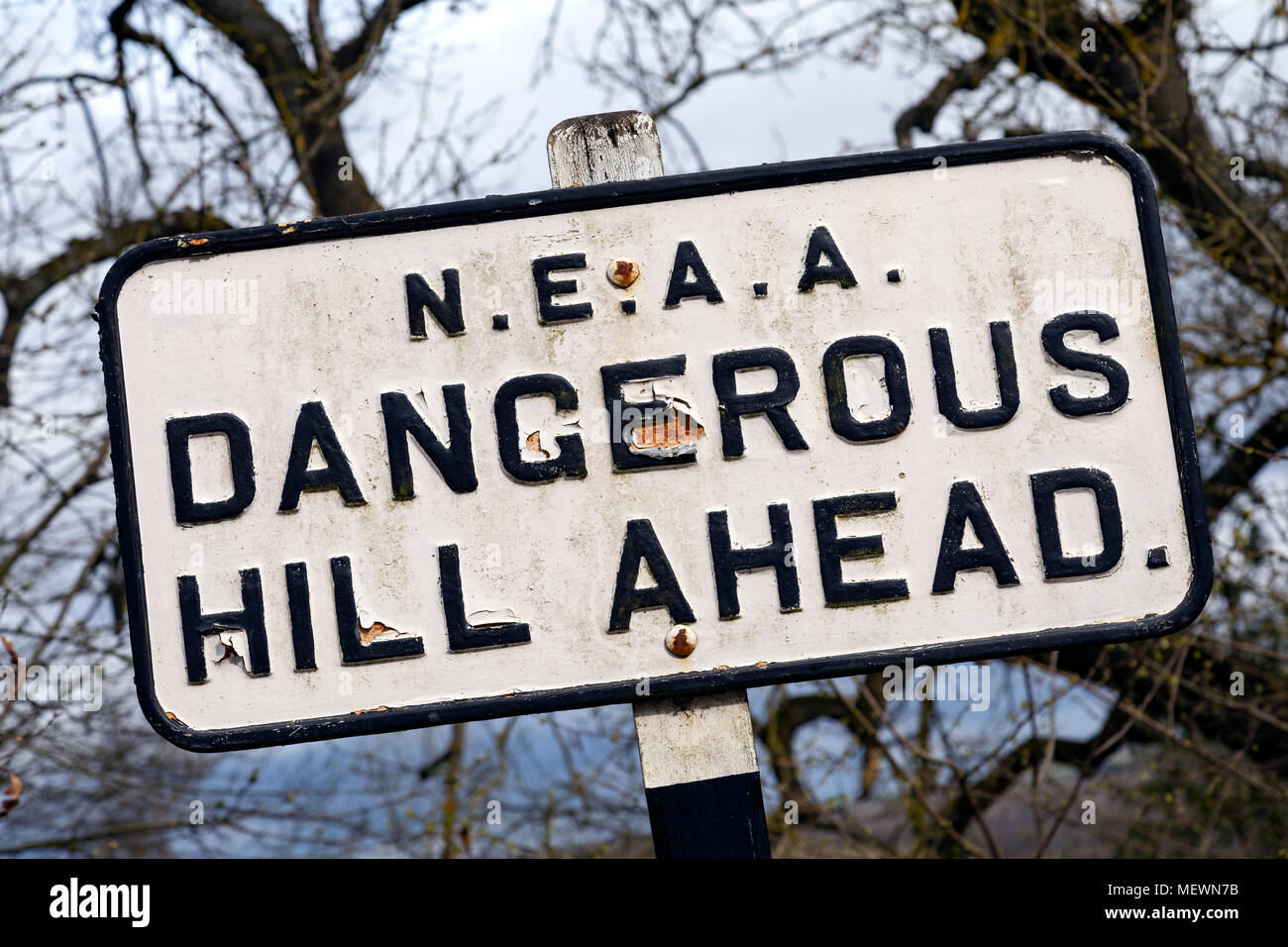 Old road sign in the northeast of England. Dangerous Hill Ahead. - Stock Image