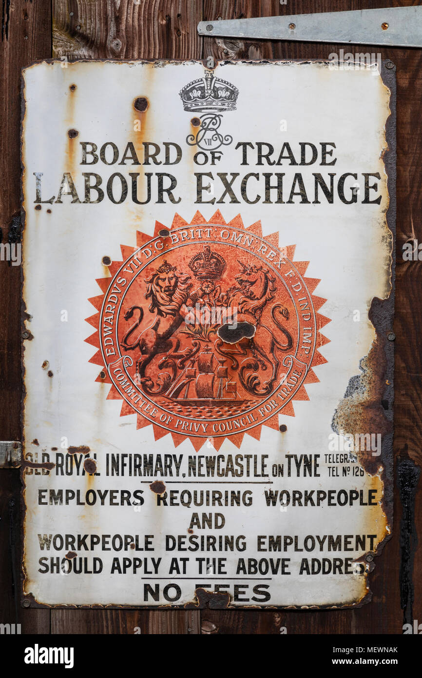 An old metal sign outside a building that was a Labour Exchange in Newcastle, England. Dates from around 1913. - Stock Image