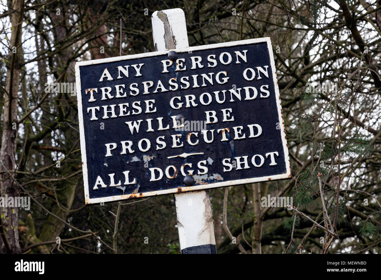 An old warning sign - No trespassing - Dogs will be shot - Stock Image