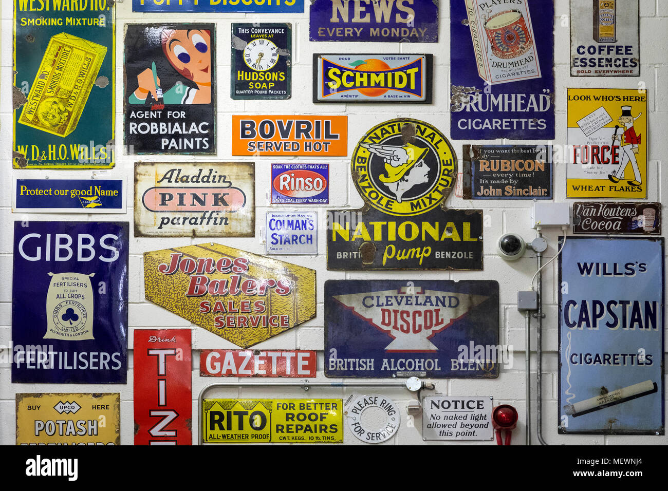 Collection of old metal advertising signs - Stock Image