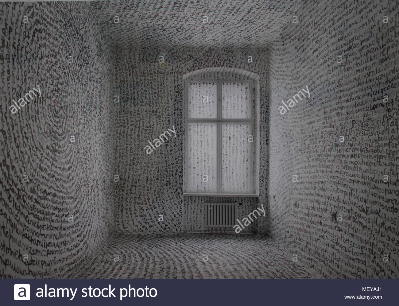 Room painted in words by tomasz madajczak on display in the uillinn gallery, skibbereen ireland. The words completely cover the walls floor and window. Stock Photo