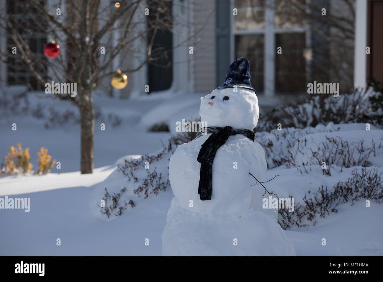 snowman wearing buffalo bills hat with large christmas balls in the back - Large Christmas Balls
