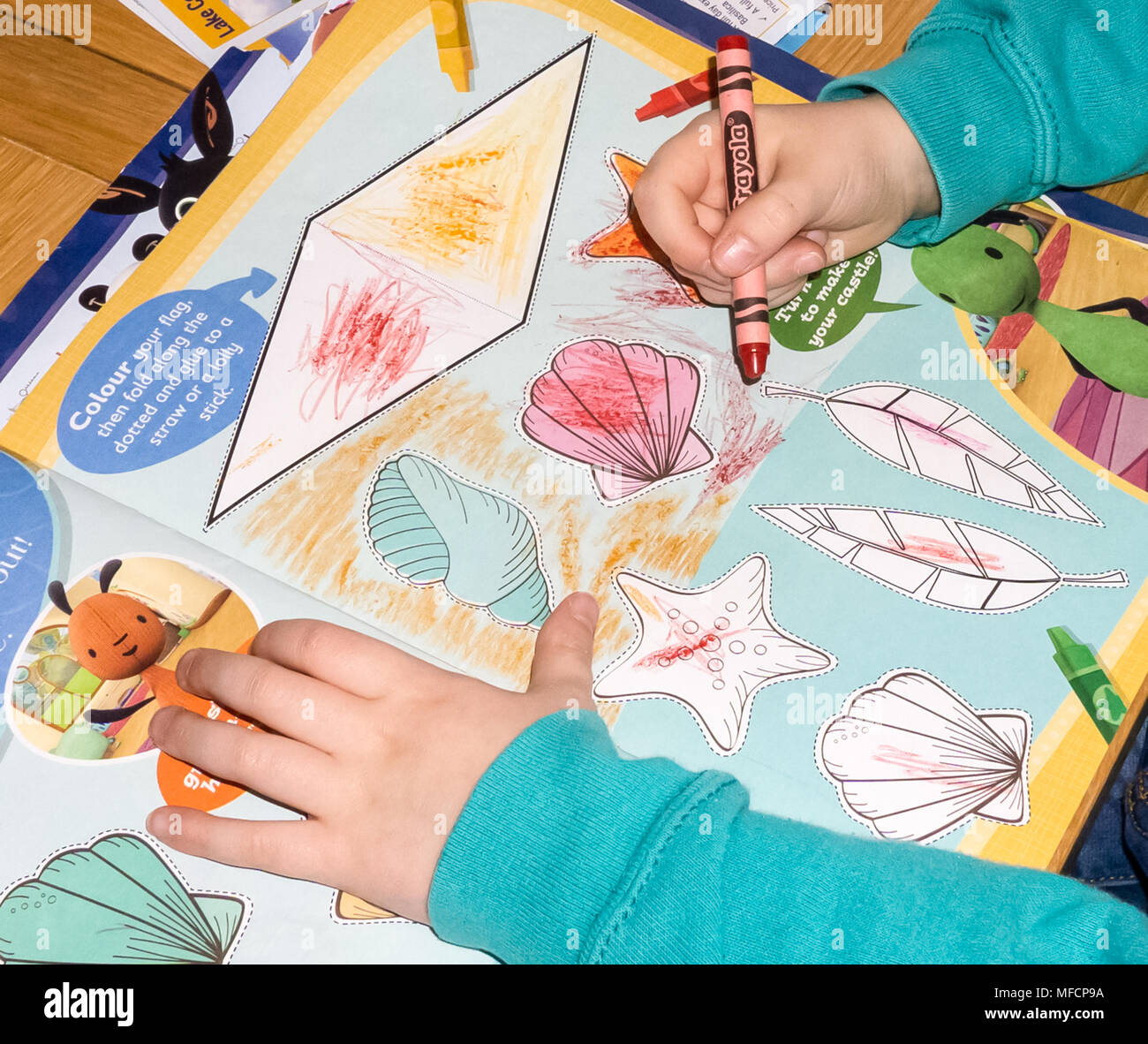 Largs, UK - March 05, 2018: A child colouring in a project from the ...
