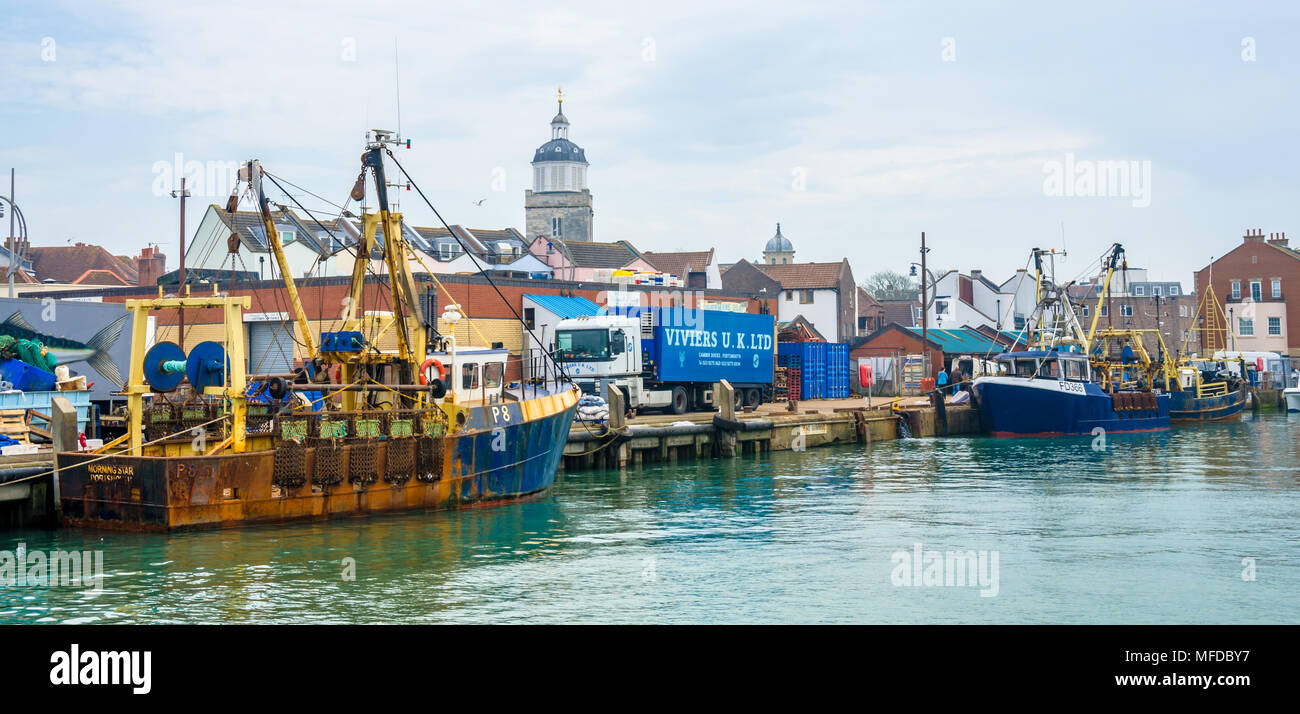 fishing-trawlers-morning-star-and-providing-star-moored-against-the-harbour-wall-in-portsmouth-uk-MFDBY7.jpg