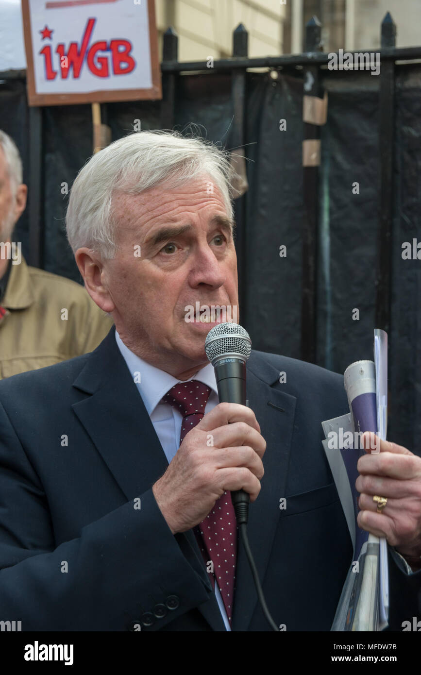 London, UK. 25th April 2018. John McDonnell speads a the rally by workers, students and other trade unionists supporting over 100 cleaners, porters, security officers, receptionists, gardeners, post room staff and audiovisual staff in the Independent Workers Union of Great Britain - IWGB at the end of the first day of a two day strike at the University of London central administration. The workers, employed by various outsourcing companies are demanding to be directly employed by the University, and receive the same conditions and benefits as directly employed colleagues; outsourced workers re - Stock Image