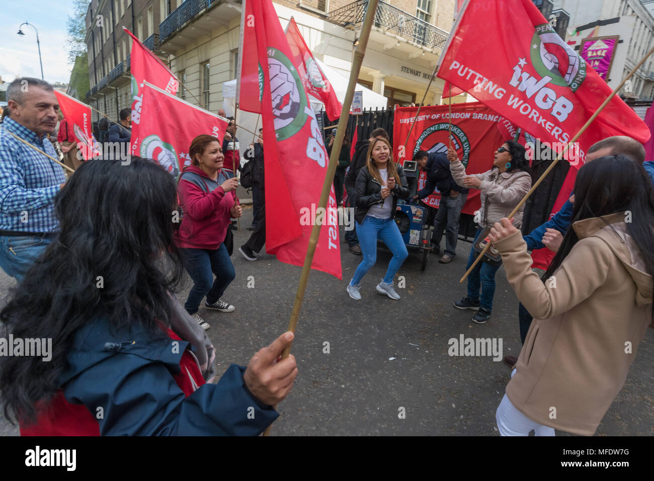 London, UK. 25th April 2018. IWGB members dance at a noisy rally by workers, students and other trade unionists supporting over 100 cleaners, porters, security officers, receptionists, gardeners, post room staff and audiovisual staff in the Independent Workers Union of Great Britain - IWGB at the end of the first day of a two day strike at the University of London central administration. The workers, employed by various outsourcing companies are demanding to be directly employed by the University, and receive the same conditions and benefits as directly employed colleagues; outsourced workers  - Stock Image