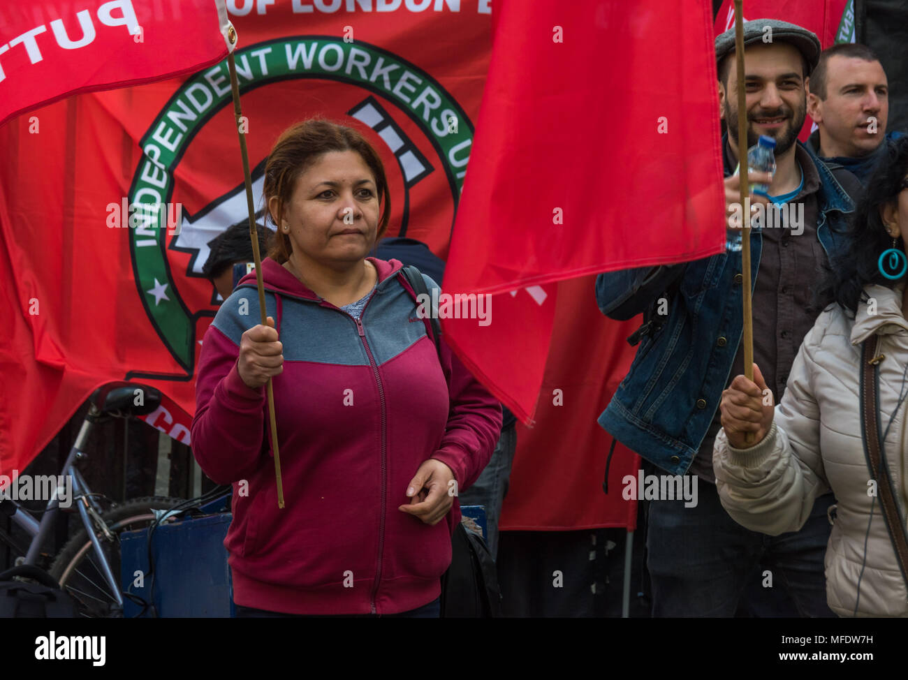 London, UK. 25th April 2018. IWGB members at a noisy rally by workers, students and other trade unionists supporting over 100 cleaners, porters, security officers, receptionists, gardeners, post room staff and audiovisual staff in the Independent Workers Union of Great Britain - IWGB at the end of the first day of a two day strike at the University of London central administration. The workers, employed by various outsourcing companies are demanding to be directly employed by the University, and receive the same conditions and benefits as directly employed colleagues; outsourced workers receiv - Stock Image