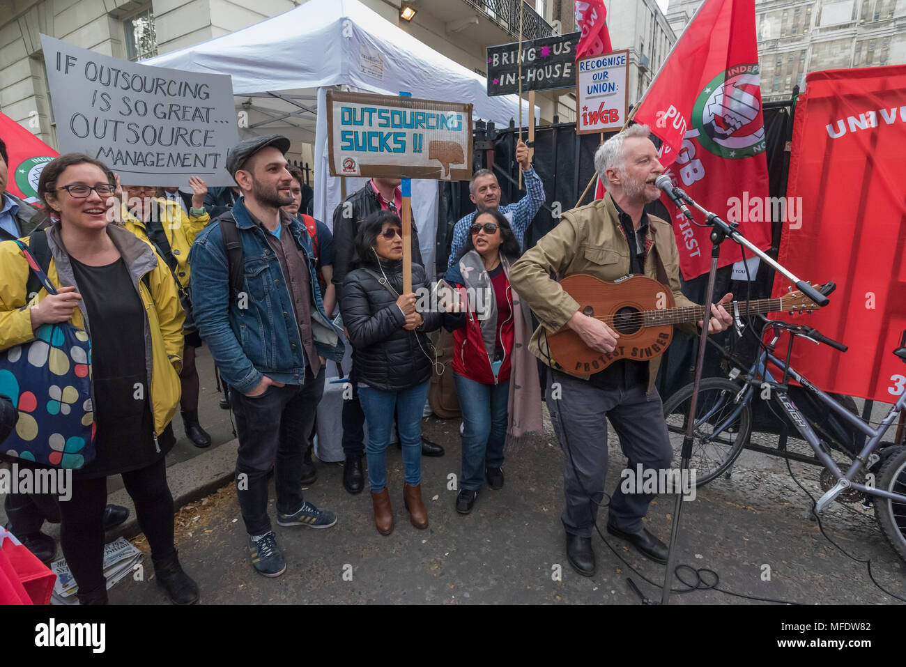 London, UK. 25th April 2018.Billy Bragg plays at the rally by workers, students and other trade unionists supporting over 100 cleaners, porters, security officers, receptionists, gardeners, post room staff and audiovisual staff in the Independent Workers Union of Great Britain - IWGB at the end of the first day of a two day strike at the University of London central administration. The workers, employed by various outsourcing companies are demanding to be directly employed by the University, and receive the same conditions and benefits as directly employed colleagues; outsourced workers receiv - Stock Image