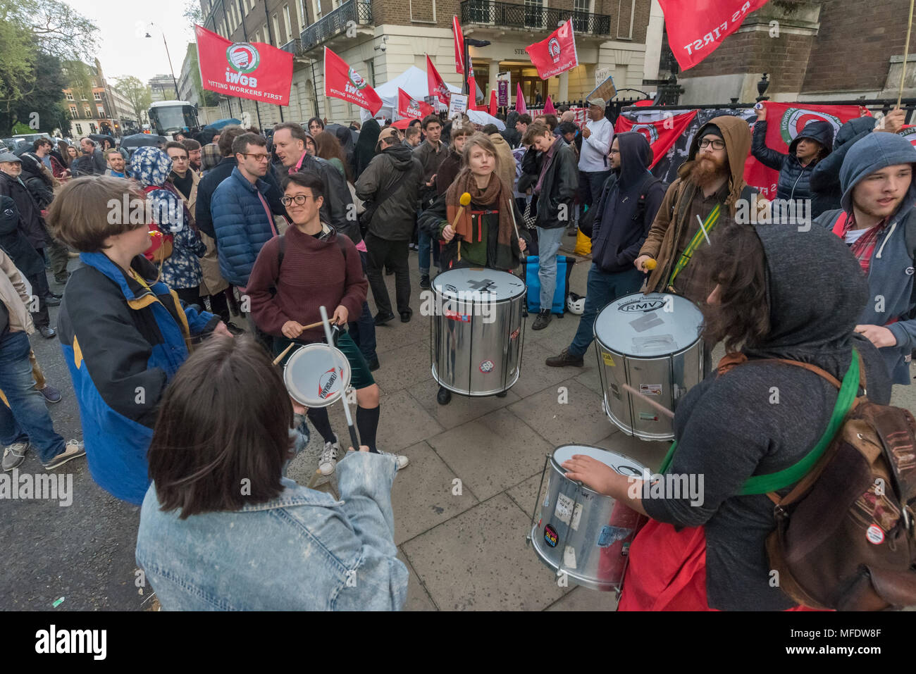 London, UK. 25th April 2018. A samba band plays at the rally by workers, students and other trade unionists supporting over 100 cleaners, porters, security officers, receptionists, gardeners, post room staff and audiovisual staff in the Independent Workers Union of Great Britain - IWGB at the end of the first day of a two day strike at the University of London central administration. The workers, employed by various outsourcing companies are demanding to be directly employed by the University, and receive the same conditions and benefits as directly employed colleagues; outsourced workers rece - Stock Image
