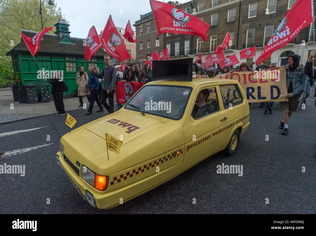 London, UK. 25th April 2018. The Precarious Workers Mobile leads a march from the rally  by workers, students and other trade unionists supporting over 100 cleaners, porters, security officers, receptionists, gardeners, post room staff and audiovisual staff in the Independent Workers Union of Great Britain - IWGB at the end of the first day of a two day strike at the University of London central administration. The workers, employed by various outsourcing companies are demanding to be directly employed by the University, and receive the same conditions and benefits as directly employed colleag - Stock Image