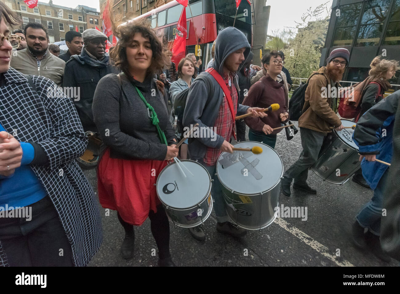 London, UK. 25th April 2018. The samba band on the march from the rally by workers, students and other trade unionists supporting over 100 cleaners, porters, security officers, receptionists, gardeners, post room staff and audiovisual staff in the Independent Workers Union of Great Britain - IWGB at the end of the first day of a two day strike at the University of London central administration. The workers, employed by various outsourcing companies are demanding to be directly employed by the University, and receive the same conditions and benefits as directly employed colleagues; outsourced w - Stock Image