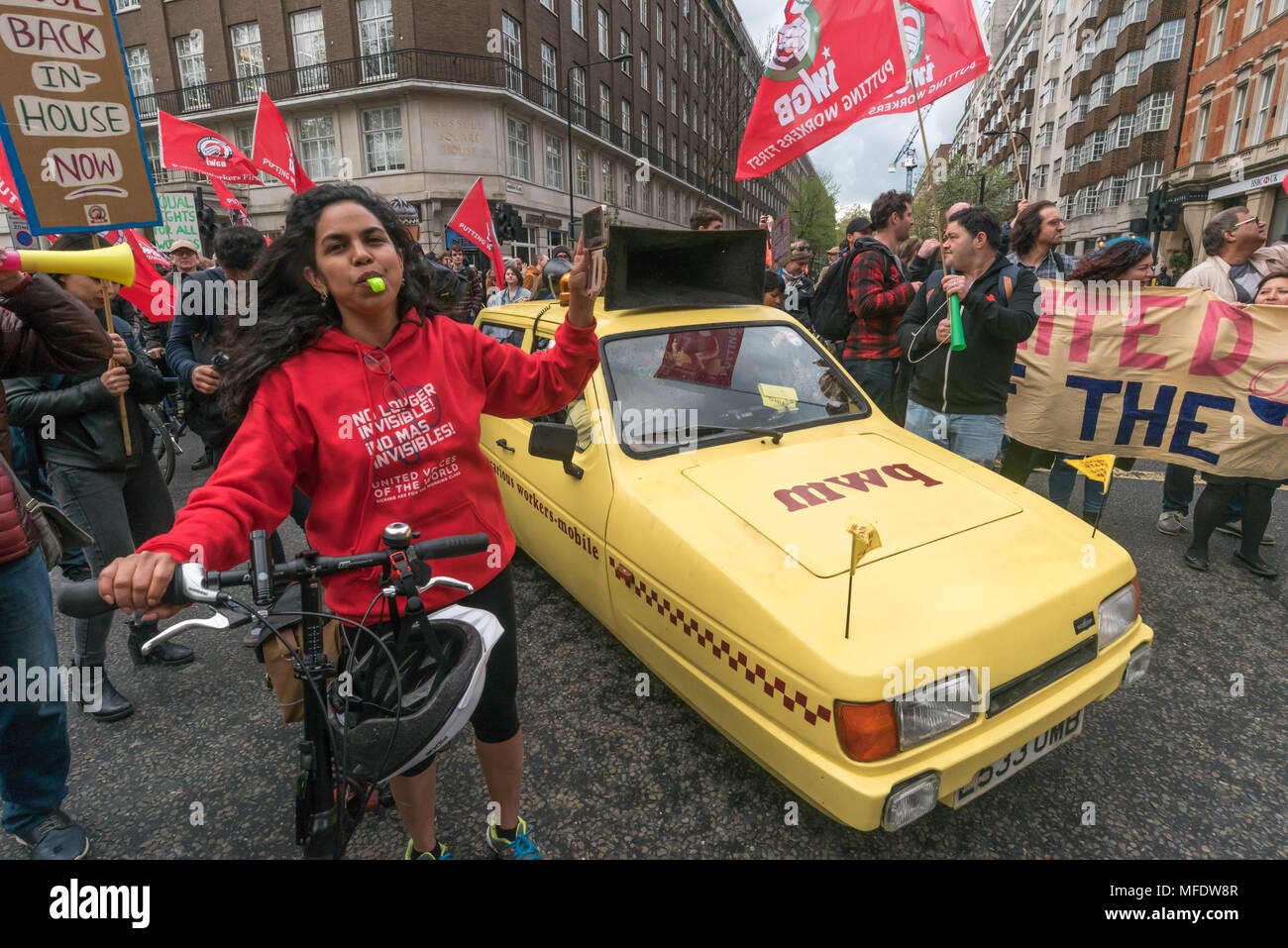 London, UK. 25th April 2018. The Precarious Workers Mobile and marchers briefly block the street on their march from the rally  by workers, students and other trade unionists supporting over 100 cleaners, porters, security officers, receptionists, gardeners, post room staff and audiovisual staff in the Independent Workers Union of Great Britain - IWGB at the end of the first day of a two day strike at the University of London central administration. The workers, employed by various outsourcing companies are demanding to be directly employed by the University, and receive the same conditions an - Stock Image
