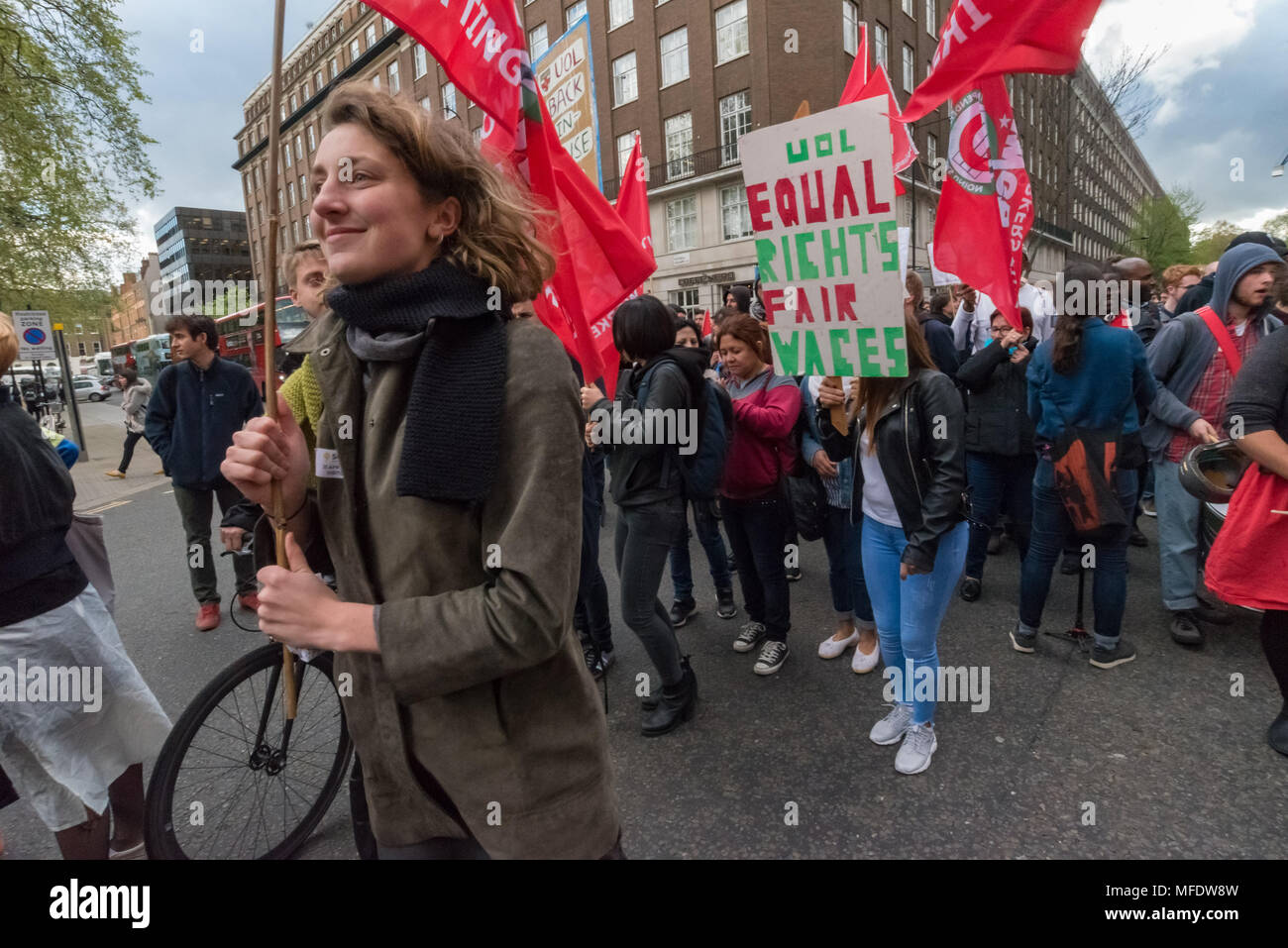 London, UK. 25th April 2018. People march around Russell Square from the rally  by workers, students and other trade unionists supporting over 100 cleaners, porters, security officers, receptionists, gardeners, post room staff and audiovisual staff in the Independent Workers Union of Great Britain - IWGB at the end of the first day of a two day strike at the University of London central administration. The workers, employed by various outsourcing companies are demanding to be directly employed by the University, and receive the same conditions and benefits as directly employed colleagues; outs - Stock Image