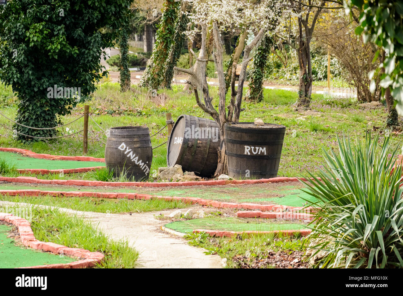 crate and barrel with rum and dynamite on a mini golf - Stock Image