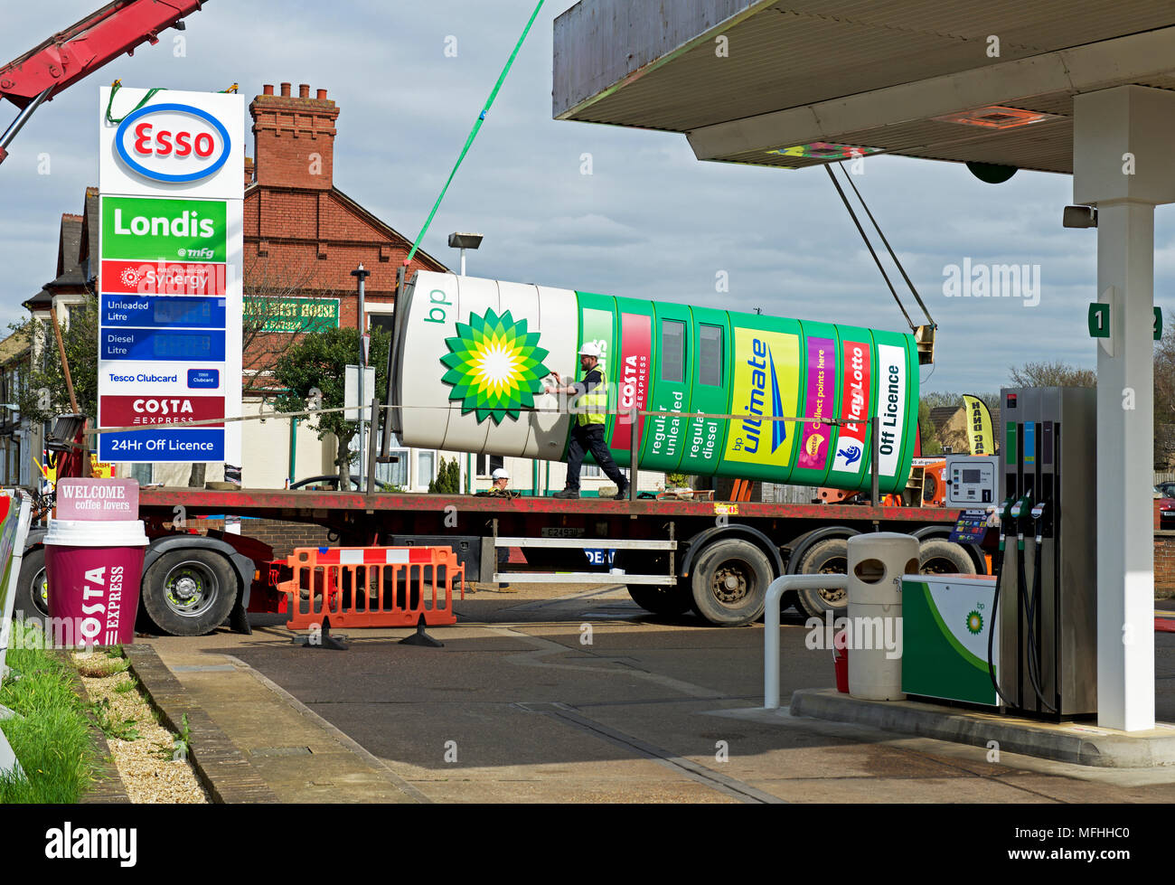 replacing-bp-sign-with-esso-sign-at-a-pe