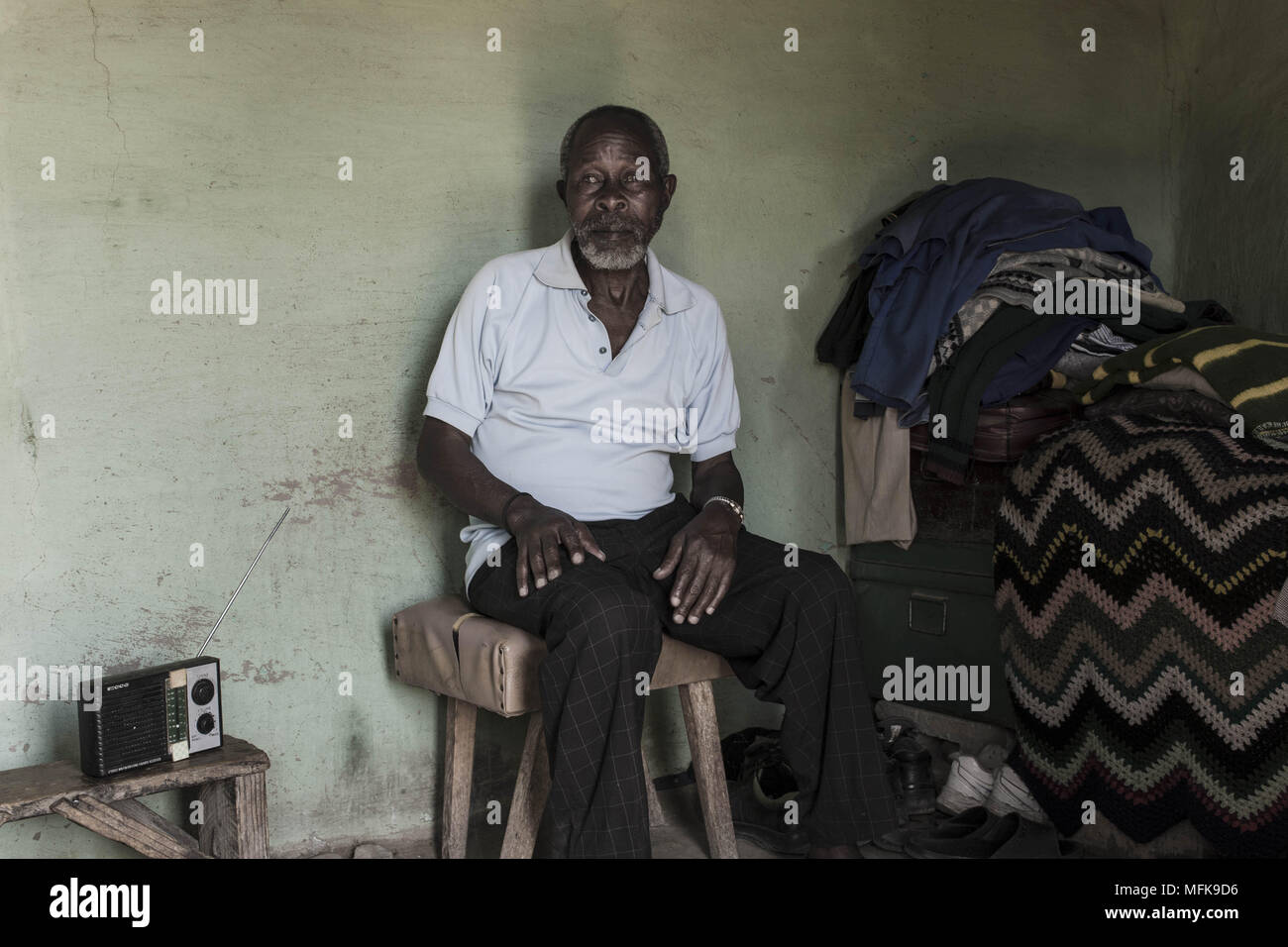 January 12 2018 Matatiele Eastern Cape South Africa Thabo 72 Wiring A House In Sits His Mud And Listens To The Radio He Complains That There Is Nothing