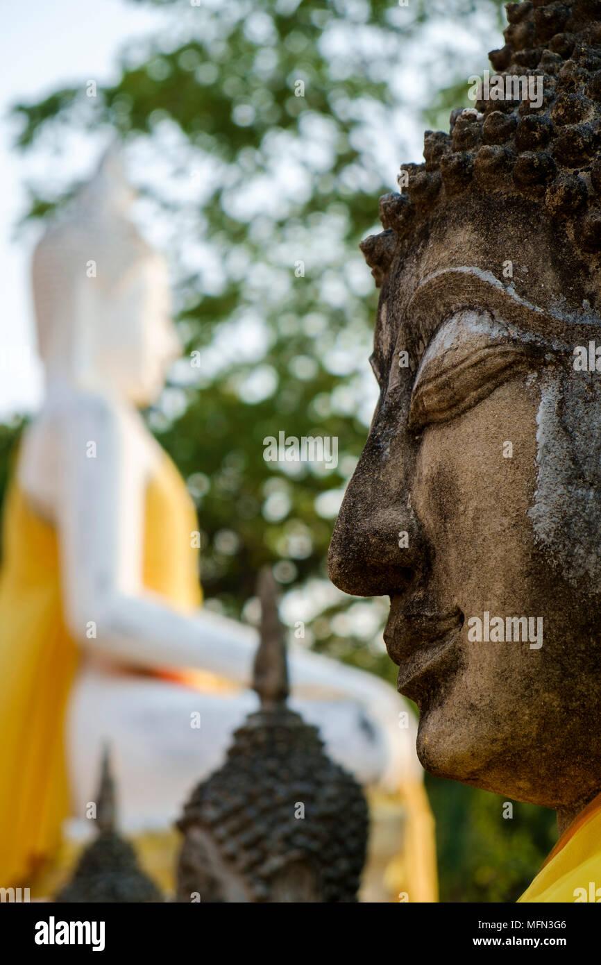 Close-up of head of a Buddha statue at Wat Yai Chai Mongkhon, a 14th century Buddhist temple, Ayutthaya, Thailand. - Stock Image