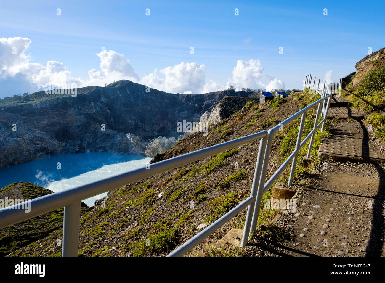 Path from upper viewpoint to the two eastern crater lakes at Mount Kelimutu, Ende Regency, Flores Island, Indonesia. - Stock Image