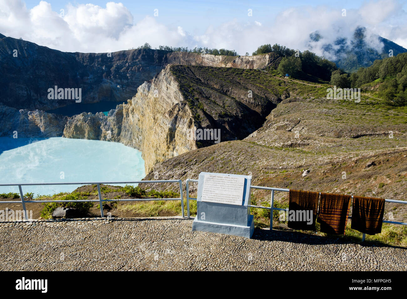 Ikat textiles for sale on viewing platform at the summit of Mount Kelimutu, Ende Regency, Flores Island, Indonesia. - Stock Image