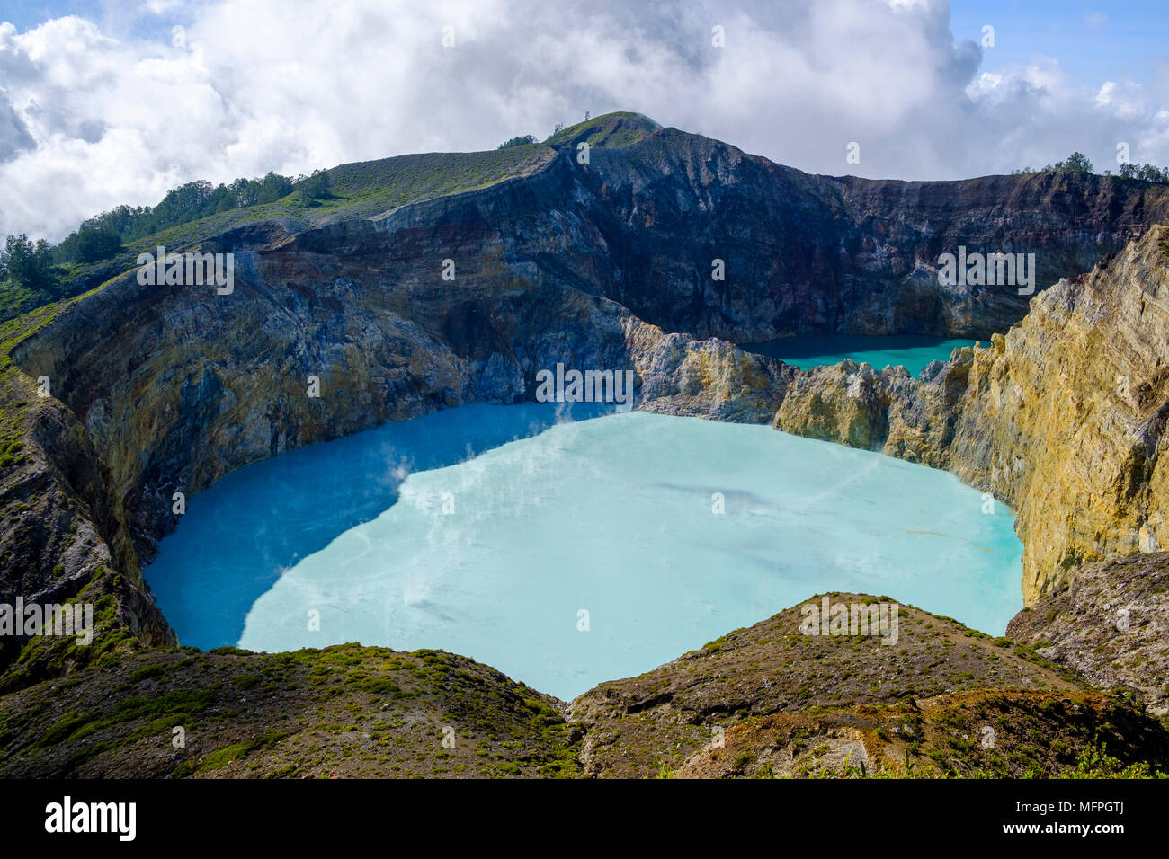 The two turquoise-coloured, eastern crater lakes at Mount Kelimutu, Ende Regency, Flores Island, Indonesia. - Stock Image