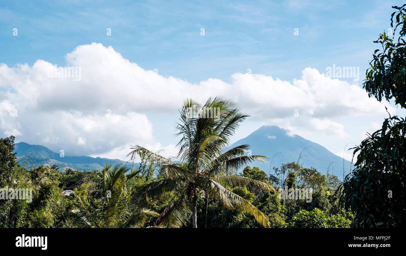 View of Ebulobo stratovolcano (right) from the road between Nangaroro to Bajawa, Flores Island (East Nusa Tenggara), Indonesia. - Stock Image