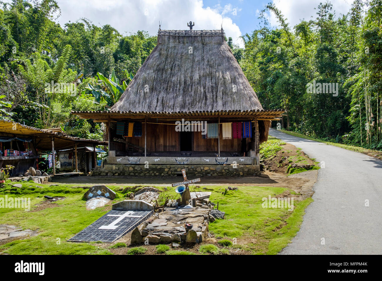 Catholic tombs in front of traditional house in Bena village, Ngada District, Flores Island, Indonesia. - Stock Image