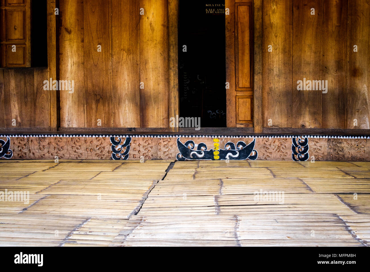 Wood carvings and paintings decorating the entrance to a traditional house in Bena, Ngada District, Flores Island (East Nusa Tenggara), Indonesia. - Stock Image