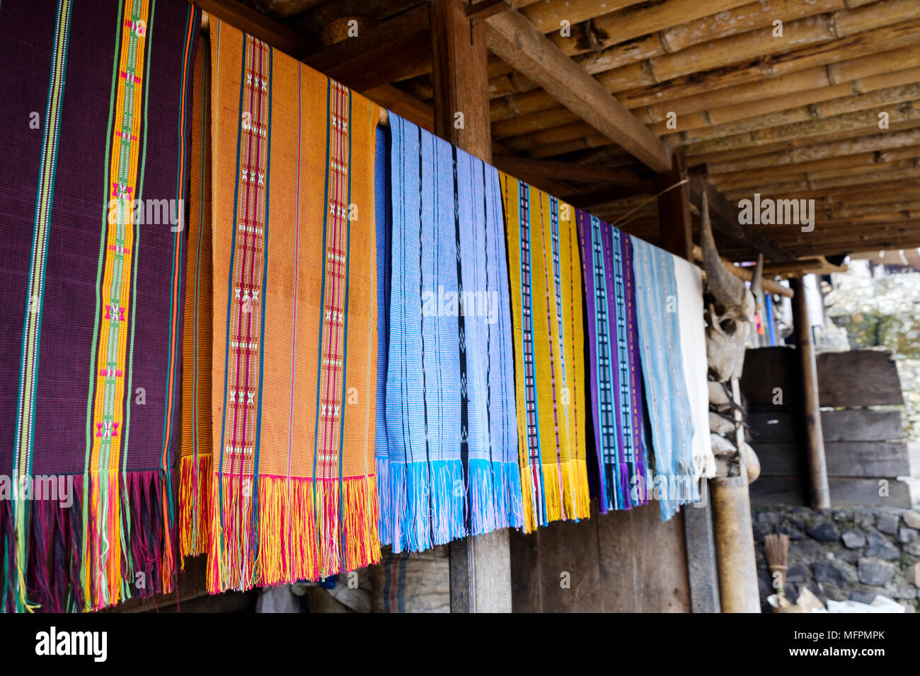 Typical 'ikat' shawls for sale at Bena traditional village, Ngada District, Island of Flores, Indonesia. - Stock Image
