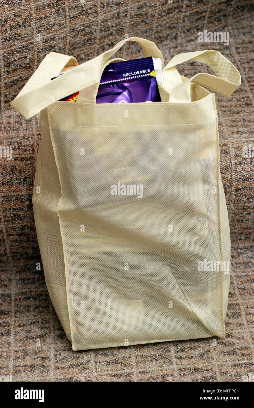 Reusable fairtrade cotton environmentally friendly shopping carrier bag used instead of plastic ones - Stock Image