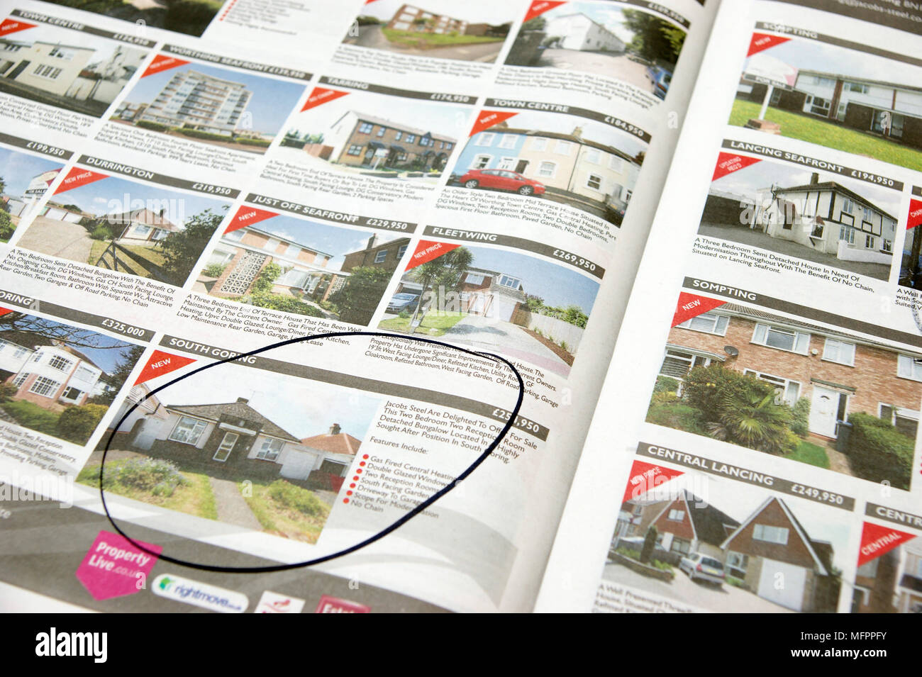 Affordable homes / properties for sale marked off in property pages of local newpaper - Stock Image