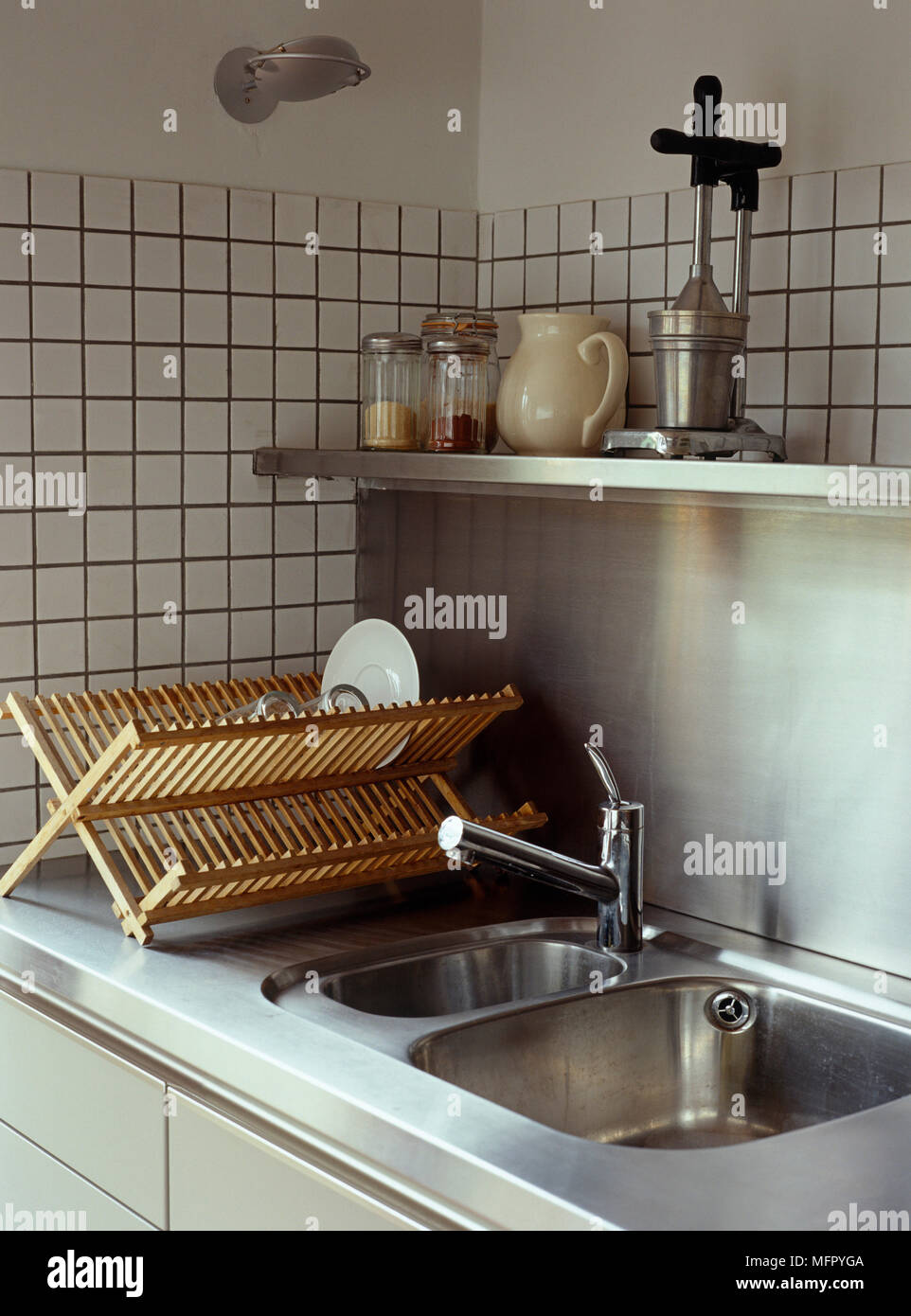 Kitchen sink and plate drainer with stainless steel splashback Stock ...