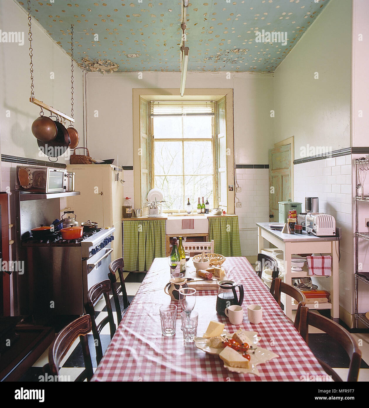 Kitchen White Walls Green Gold Ceiling Bay Window Venetian Blinds Long  Table Wooden Chairs Appliances Interiors Rooms Dining Area Kitchens  Utensils Ha