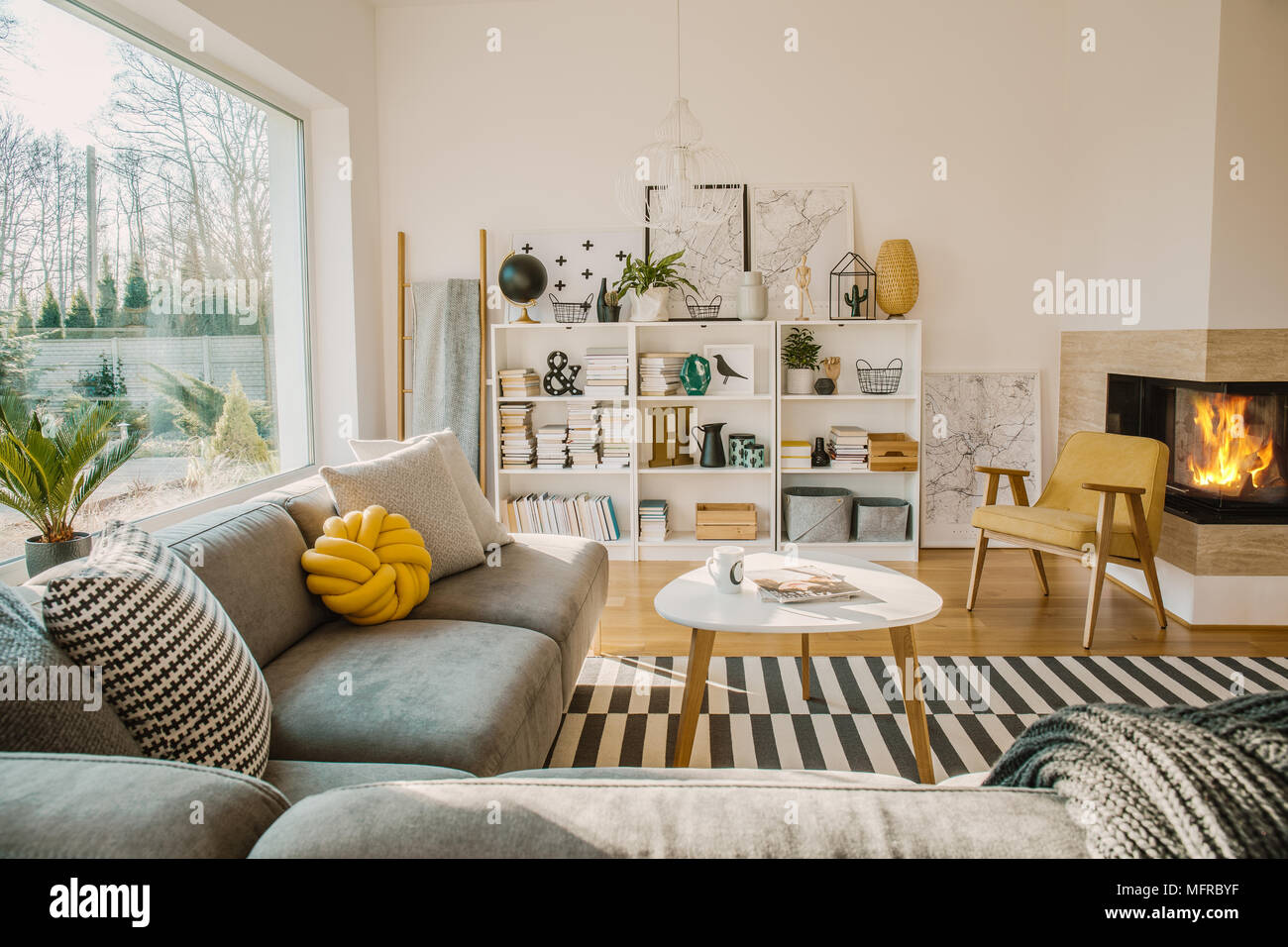 Exceptionnel White Wooden Rack With Books, Decorations, Fresh Plants And Simple Posters  In Bright Scandinavian Living Room Interior With Fireplace, Coffee Table An