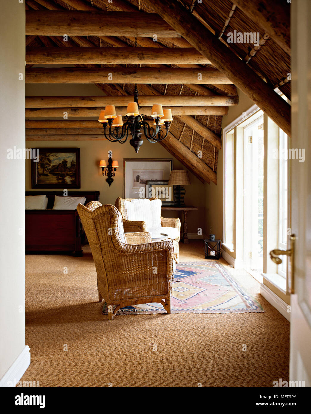 Bedroom wooden beams thatched ceiling slanted roof light green walls ...