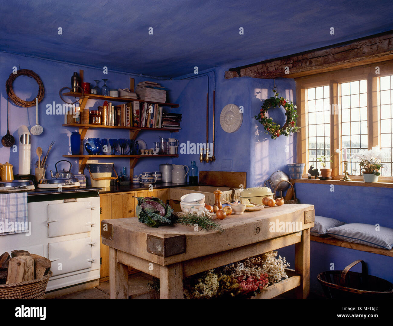 Blue country kitchen with butcher block worktable beamed bay window with window seat white oven and open shelving. & Blue country kitchen with butcher block worktable beamed bay window ...